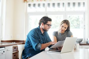 Shot of a young couple working on their finances together at home